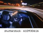 driving at night on a highway... | Shutterstock . vector #610930616
