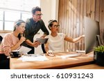 coworkers looking at a computer ... | Shutterstock . vector #610931243