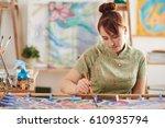 pretty female artist... | Shutterstock . vector #610935794