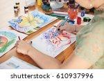 hands of creative woman drawing ... | Shutterstock . vector #610937996