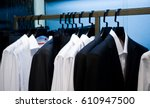 row of men's suits hanging in... | Shutterstock . vector #610947500