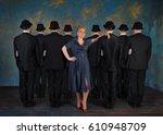 serious businesswoman is ahead... | Shutterstock . vector #610948709