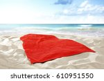 summer time and towel on beach  | Shutterstock . vector #610951550