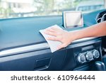hand cleaning the car interior... | Shutterstock . vector #610964444