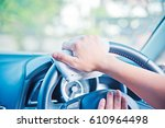 hand cleaning the car interior... | Shutterstock . vector #610964498