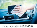hand cleaning the car interior... | Shutterstock . vector #610964534