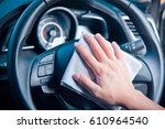 hand cleaning the car interior... | Shutterstock . vector #610964540