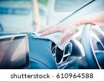 hand cleaning the car interior... | Shutterstock . vector #610964588
