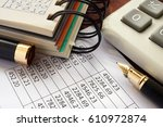 Small photo of Balance sheet and accounting data on a table.
