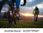 mountainbike sunset sunrise | Shutterstock . vector #610979969