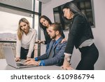 business man surrounded by his... | Shutterstock . vector #610986794