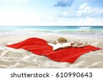 towel on hot sand of free space ...   Shutterstock . vector #610990643