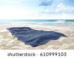 towel on beach of free space... | Shutterstock . vector #610999103