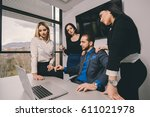 business man surrounded by his... | Shutterstock . vector #611021978
