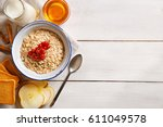oat flakes plate with honey ... | Shutterstock . vector #611049578