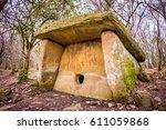 dolmen in the forest. near... | Shutterstock . vector #611059868
