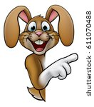 a cartoon rabbit or easter... | Shutterstock .eps vector #611070488