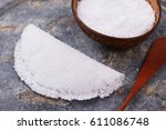 Small photo of Casabe (bammy, beiju, bob, biju) - flatbread of cassava (tapioca) on gray background. Selective focus