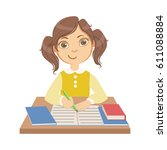 cute little girl writing at... | Shutterstock .eps vector #611088884