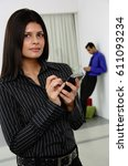 Small photo of Businesswoman with PDA, looking at camera