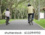 a father and son ride their... | Shutterstock . vector #611094950