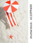 red and white sunbed on the... | Shutterstock . vector #611099600