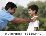 father and son looking at each... | Shutterstock . vector #611103440