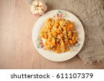 the pilaf with spices  garlic ... | Shutterstock . vector #611107379