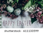 happy easter text sign on ... | Shutterstock . vector #611133599