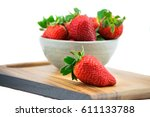 a bowl of ripe strawberry on... | Shutterstock . vector #611133788