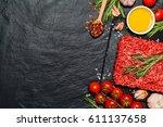 minced meat on a slate stone... | Shutterstock . vector #611137658