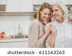 cute young daughter embracing... | Shutterstock . vector #611163263