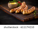 four succulent grilled pork... | Shutterstock . vector #611174210