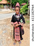 Small photo of Pak Nam Noy, Laos-October 8, 2015: The Akha Pala hill tribe are an ethnic minority living in the area between E.Myanmar-N.Thailand-W.Laos-S.China. Old woman sells crafts to tourists visiting the town.