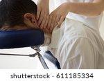 businessman receiving shiatsu... | Shutterstock . vector #611185334