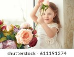 small girl in colorful dress... | Shutterstock . vector #611191274