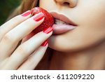 sexy woman eating strawberry.... | Shutterstock . vector #611209220