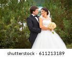 wedding shot of bride and groom | Shutterstock . vector #611213189