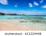 beautiful and remote beach at... | Shutterstock . vector #611224448