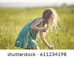 Girl In The Field At Sunny...