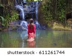 young woman in jungle waterfall ... | Shutterstock . vector #611261744