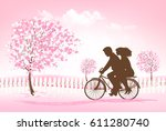 couple riding a bike in a park. ... | Shutterstock .eps vector #611280740