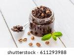 body scrub of ground coffee on... | Shutterstock . vector #611293988