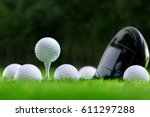 golf balls and golf club on... | Shutterstock . vector #611297288