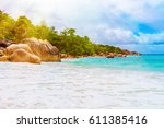 photo of a tropical beach on... | Shutterstock . vector #611385416