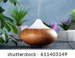 aroma oil diffuser on wooden... | Shutterstock . vector #611403149