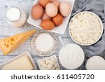 dairy products on wooden table. ... | Shutterstock . vector #611405720