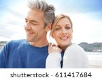 middle aged couple embracing... | Shutterstock . vector #611417684