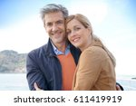 middle aged couple embracing... | Shutterstock . vector #611419919