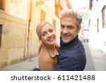 middle aged couple walking in...   Shutterstock . vector #611421488